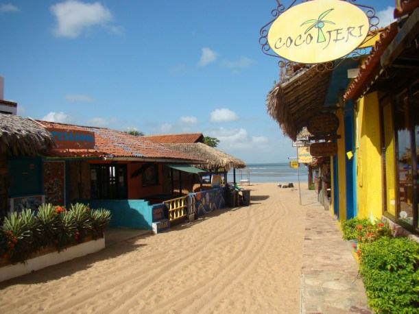 Sandy street in Jericoacoara with ocean
